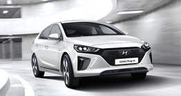 ioniq-plug-in-hybrid-gallery-side-front-white-driving-carpark-tower-pc