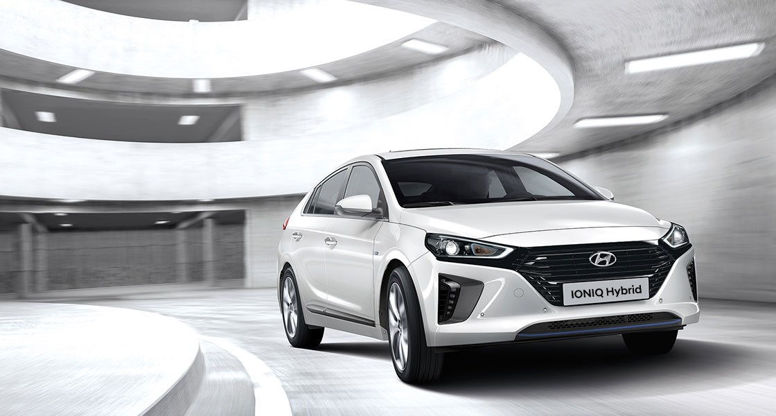 ioniq-hybrid-gallery-side-front-white-driving-carpark-tower-original-1