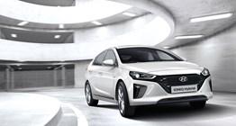 ioniq-hybrid-gallery-side-front-white-driving-carpark-tower-original-1
